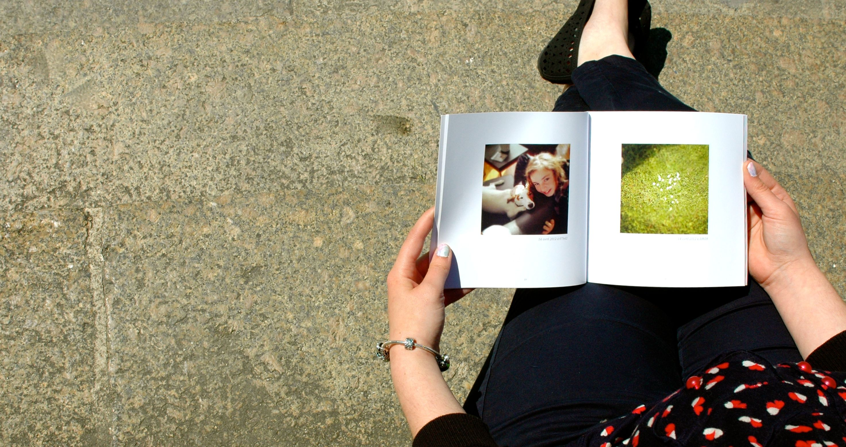 A person holding the book of her blog
