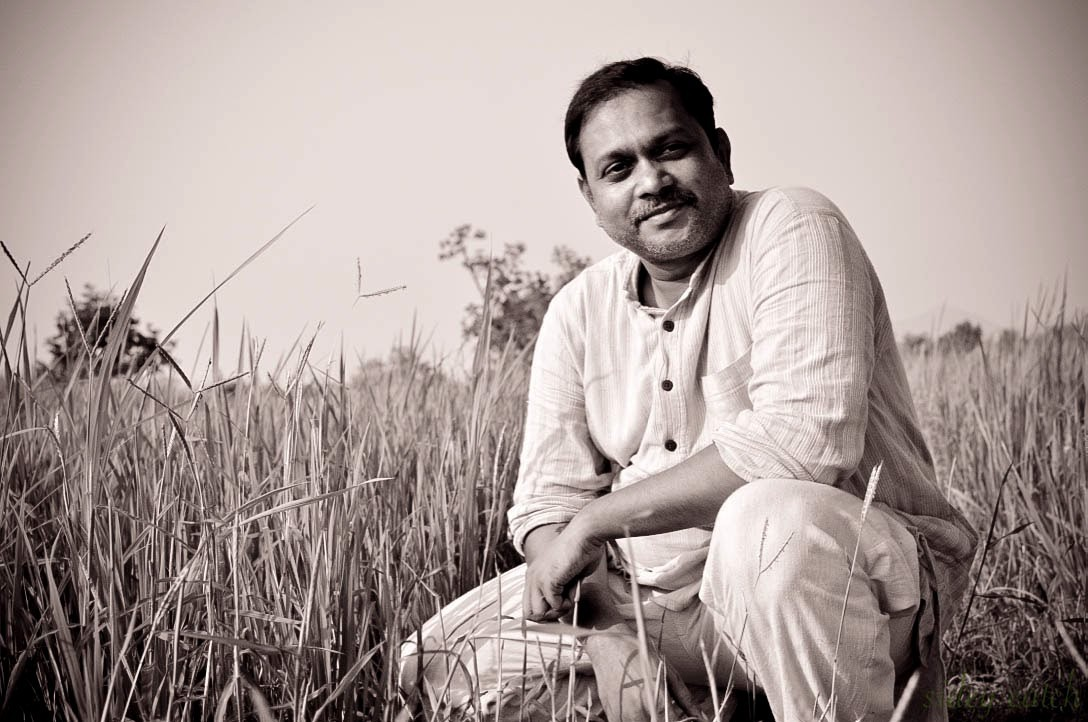 Sidhartha in a field in India