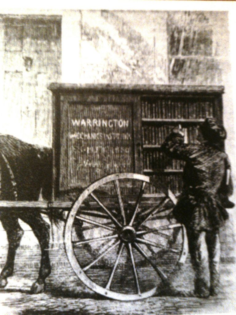 An old bookmobile pulled by a horse